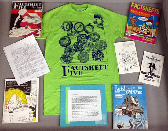 Dispaly case with Factsheet Five T-shirt and assorted issues of the zine.